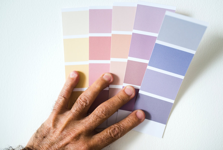 Person comparing color swatches and staging ideas