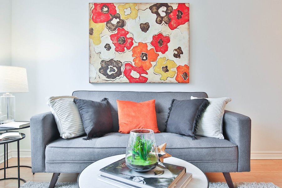 Couch with wall art and staging ideas